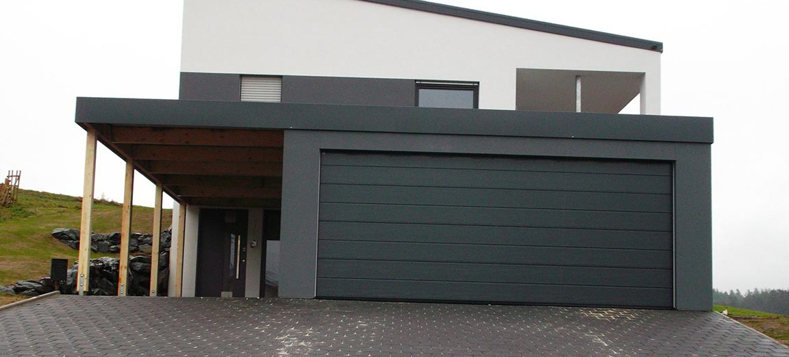 Profilwandgarage fertiggarage im massiv look for Haus mit doppelgarage